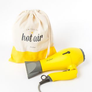 No more hotel hair-dryers! The ultimate travel dryer delivers 100% of the performance of most full-sized dryers, and its compact size provides Drybar hair anywhere!
