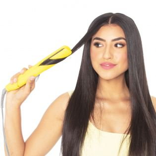 It straightens! It curls! It smooths! It shines! This dual-purpose iron allows you to quickly style even the thickest hair into super-sleek straight looks or add a bit of wave or curl.